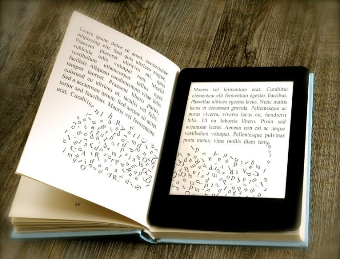 modern ebook reader on book on wooden background